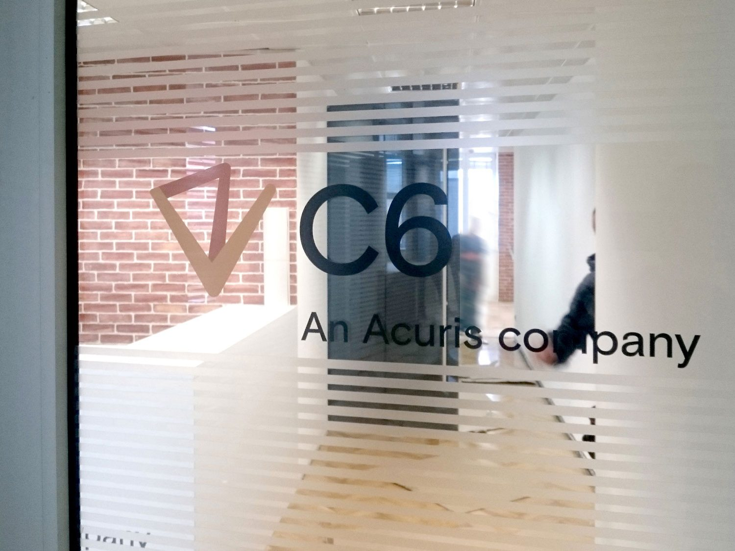 Glass door branded with C6's logo