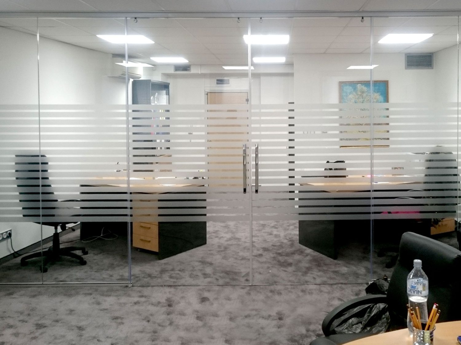 Office glass wall decorated with horizontal vinyl lines