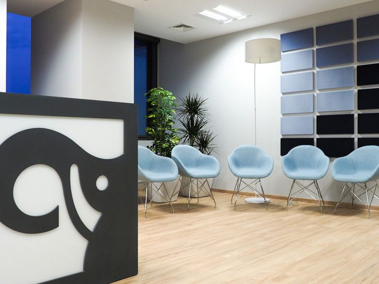 Waiting room with large Cargotec logo on the reception desk