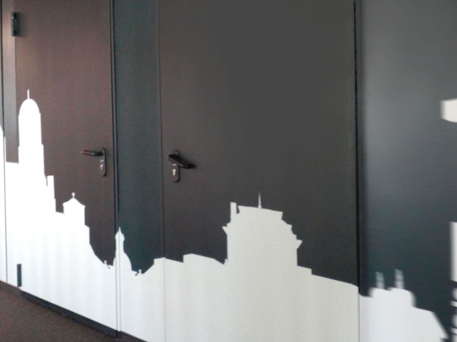 Black wall decorated with white cityline