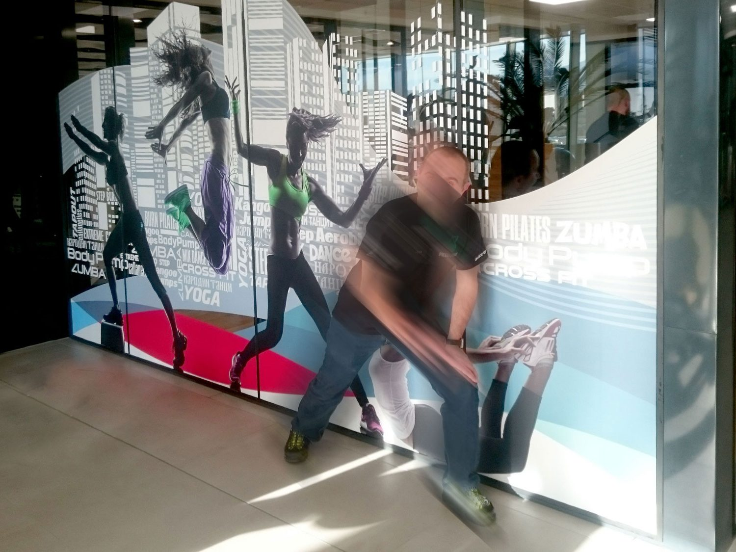 Colorful image of dancing people on a glass wall