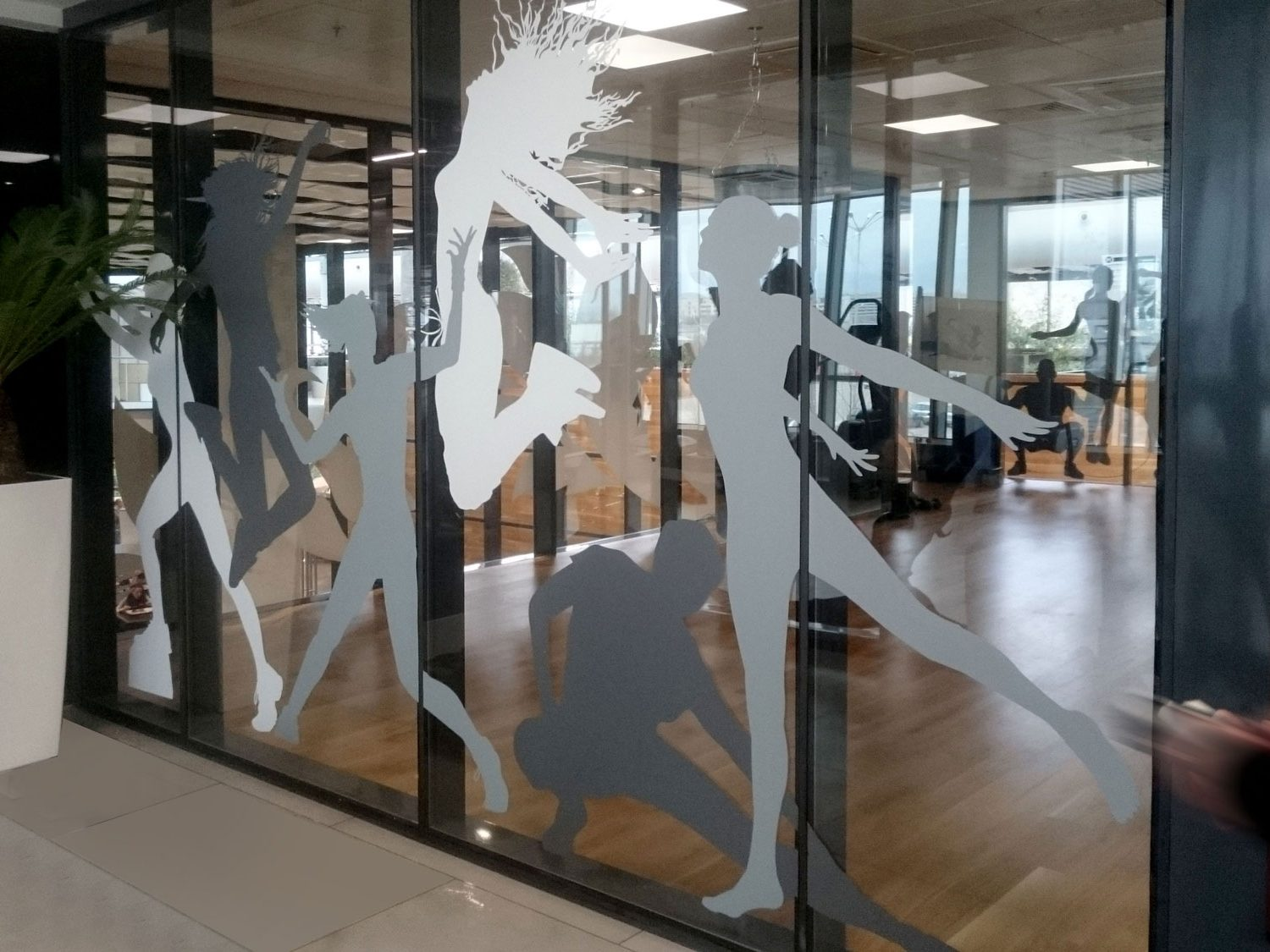 Decorated glass with images of dancing people