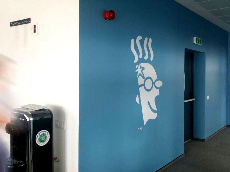 Blue wall branded with big GoDaddy logo
