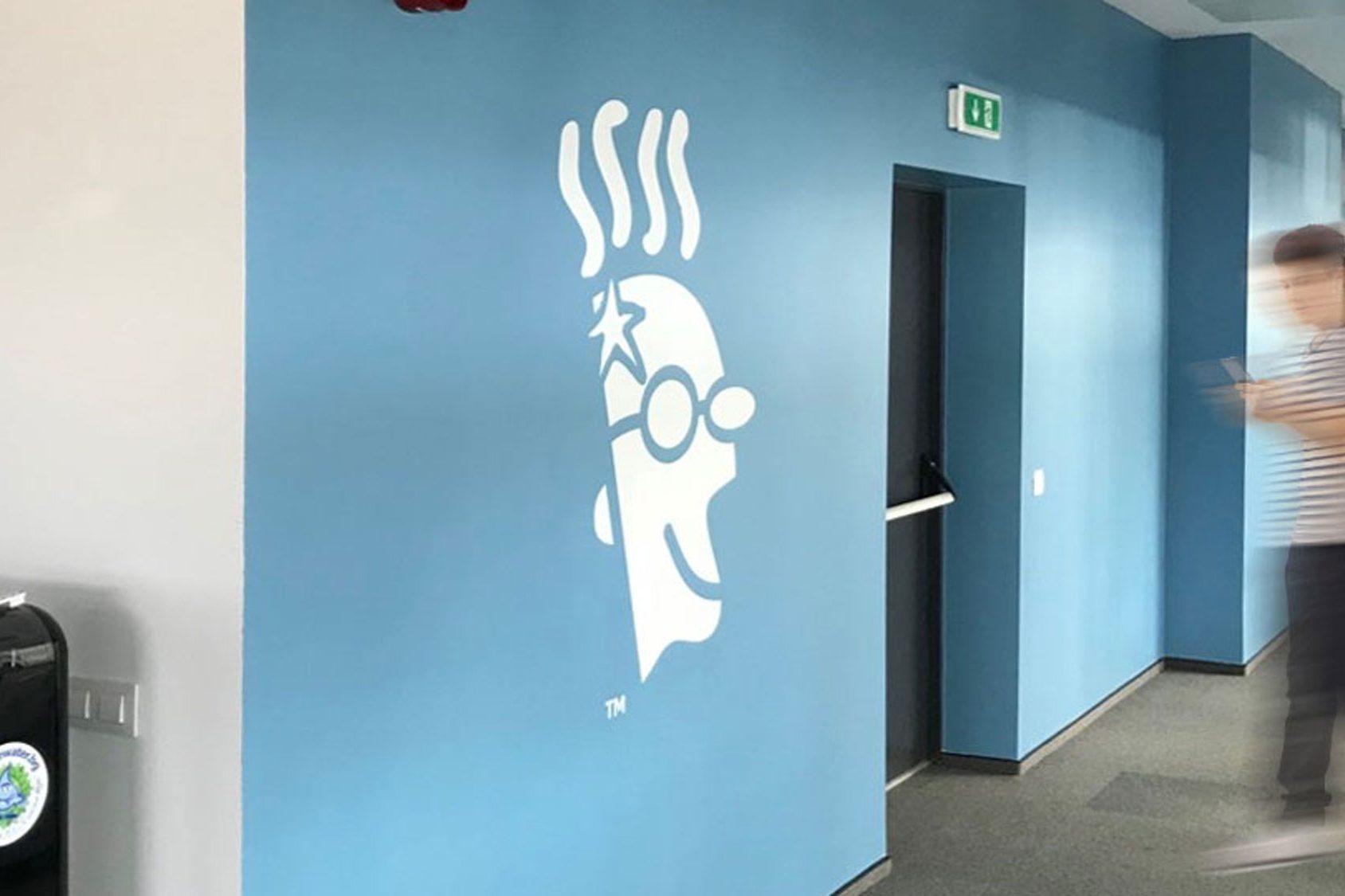 Light blue wall branded with GoDaddy logo