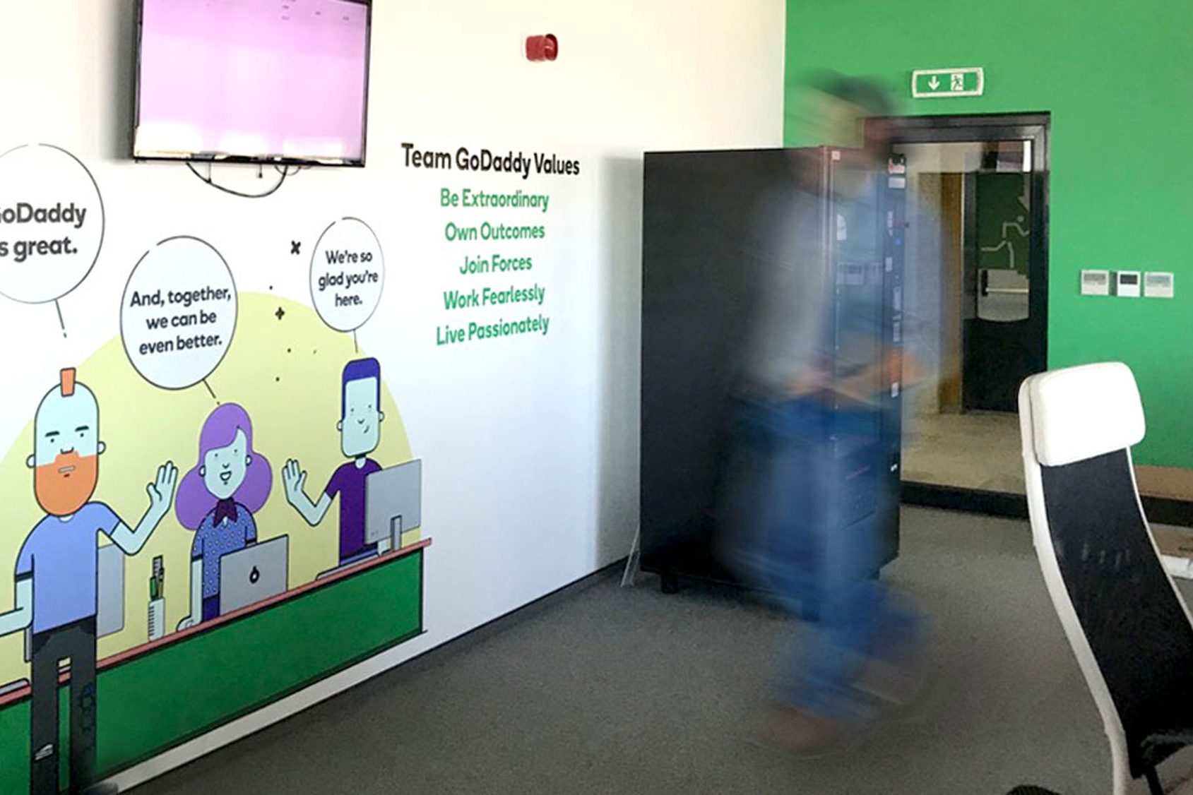 Decorated wall with motivational text and fun illustration