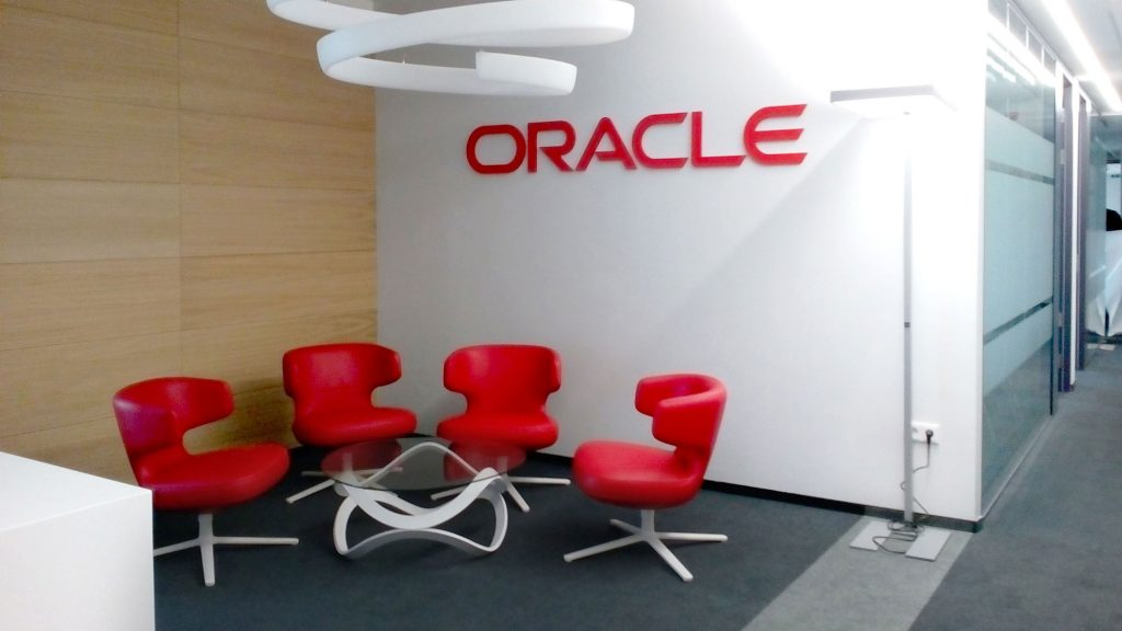 Waiting room with large Oracle logo on the wall
