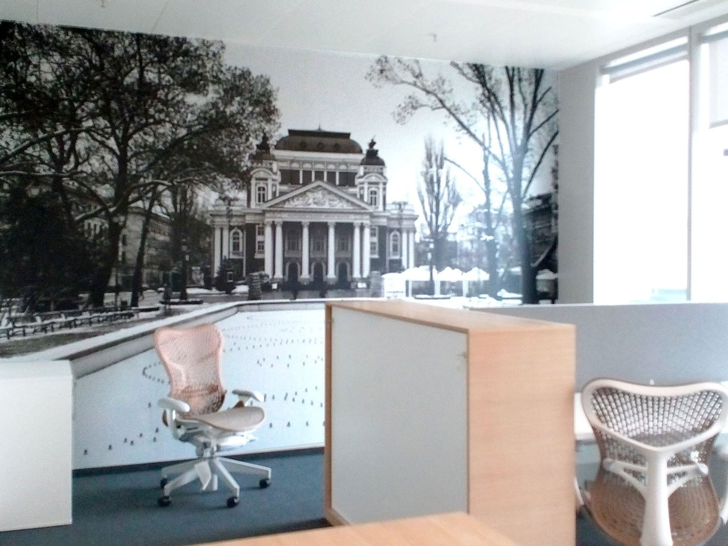 Room with printed wallpaper with image of the national theatre