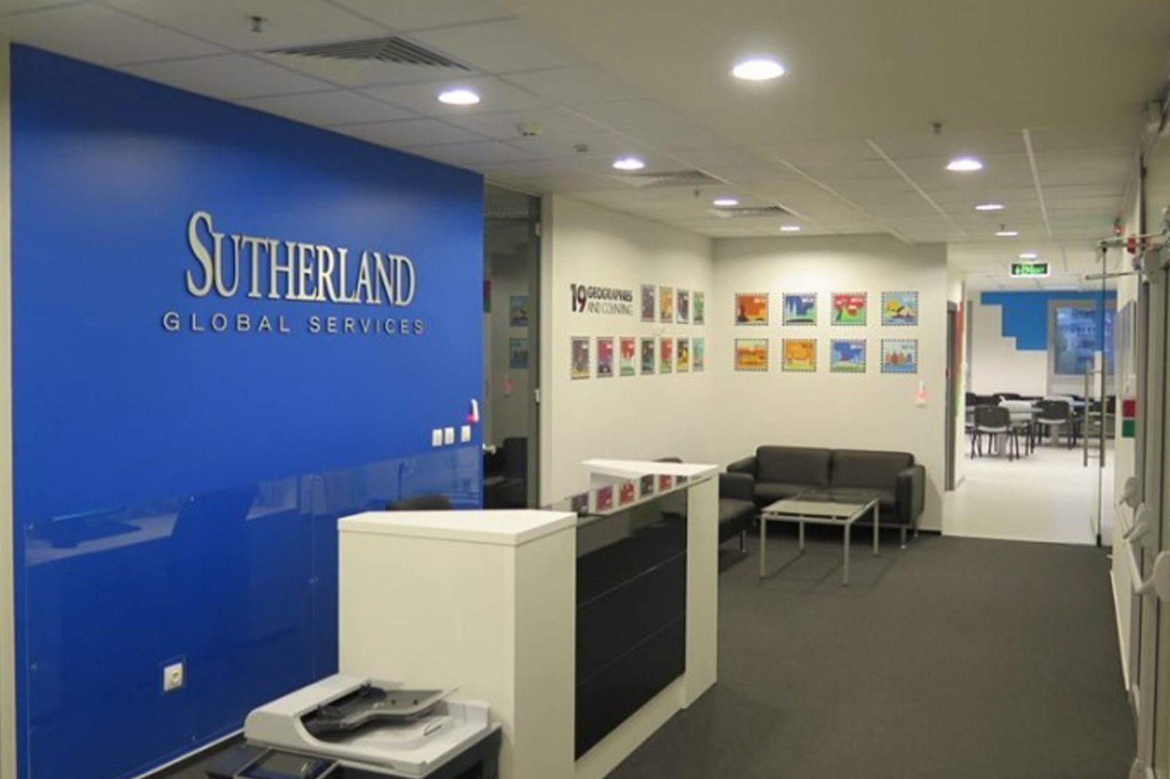 Waiting room with Sutherland logo on a blue wall