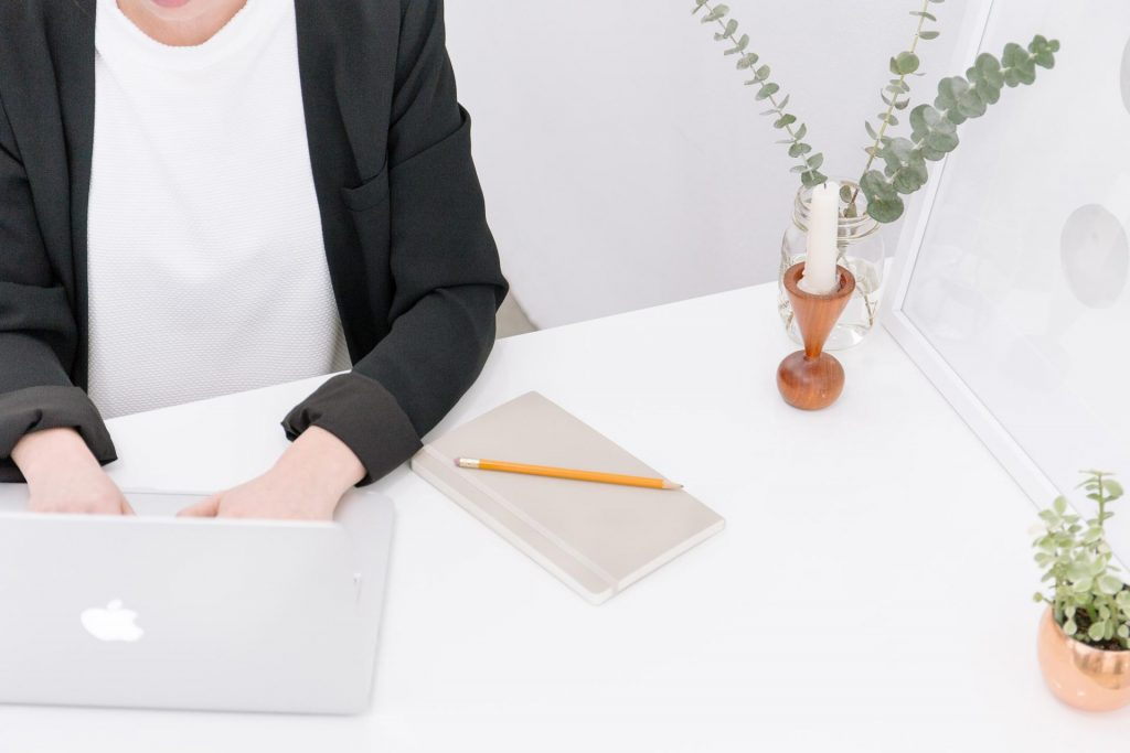 Business girl working on a white desk.